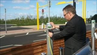 Motorbike being charged at Taunton Park and Ride
