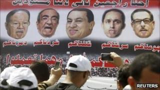 Defaced poster showing NPD members, 1 April 2011