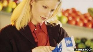 Woman reading milk carton