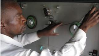 Man looping tape onto a cassette machine