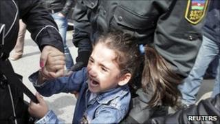 """Girl taken away in Baku after shouting """"freedom"""". File photo"""