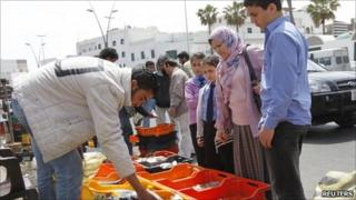 Selling fish to residents in Tripoli on 16/4/11