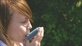 Asthma sufferer using inhaler