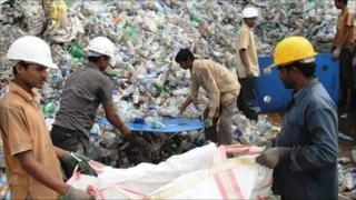 Workers at an Indian polyester recycling plant