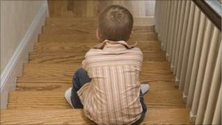Boy sitting on stairs (model)