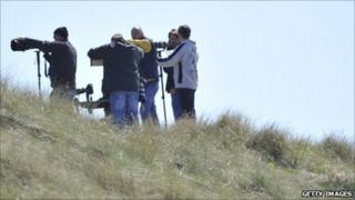 Photographers near the perimeter of RAF Valley in Anglesey, north Wales May 3, 2011