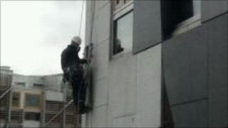 A contractor working on the loose granite block