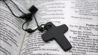 A cross on an open page of the bible