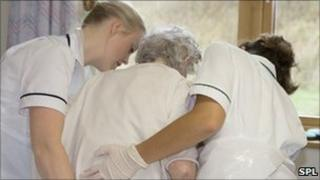 nurses caring for a patient