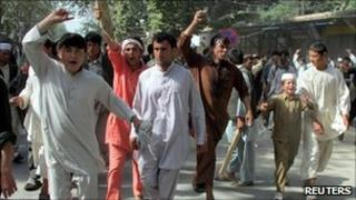 Afghans chant slogans as they protest the killing of four people overnight after a raid by NATO and Afghan forces, in Taloqan May 18, 2011.