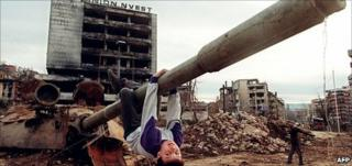 A boy playing on a tank in the Sarajevo neighbourhood of Grbavica, April 1996