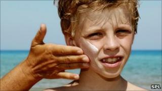 Sun cream being applied