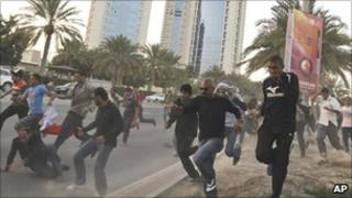 Protesters flee in Manama, 15 Feb