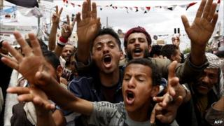 Yemeni anti-government protesters shout slogans during a demonstration calling for the removal of President Ali Abdullah Saleh in Sanaa on June 2, 2011