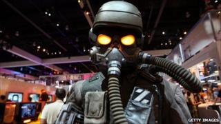A character from the game Kill Zone 3 attempting to scare individuals walking through the Sony PlayStation booth