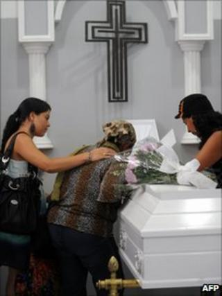Relatives mourn next to the coffin with the remains of Ana Fabricia Cordoba, during her wake on 8 June 8, 2011 in Medellin