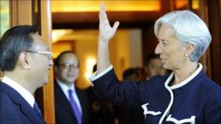 French finance minister Christine Lagarde (R) talks to Chinese Foreign Minister Yang Jiechi