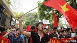 Anti-China protesters wave the Vietnamese national flag during a demonstration in Hanoi (12 June)