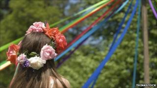 Maypole and dancer