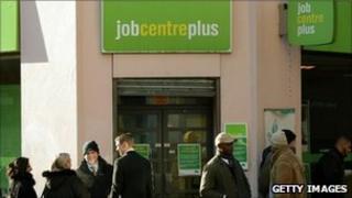 People queue outside a Job Centre Plus branch