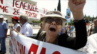 An elderly protester shouts slogans during a rally against the government's latest austerity measures