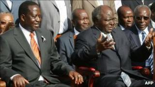 Kenya's Prime Minister Raila Odinga and President Mwai Kibaki seated in parliament (archive shot)