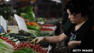 Consumer buying vegetables in China