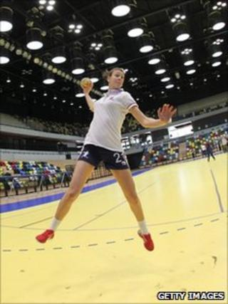 A handball player in the London Olympic venue