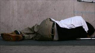 Homeless man sleeping on street