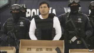 "Federal police agents present Jesus Enrique Aguilar, alias ""El Mamito"" to the media in Mexico City, 4 July 2011"