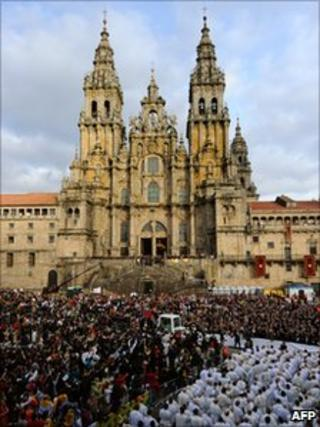 Crowds wait outside the Santiago de Compostela cathedral in northern Spain during a visit by Pope Benedict XVI on 6 November 2010