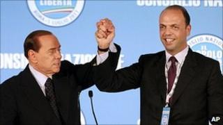 Italian Prime Minister Silvio Berlusconi (left) congratulates new PdL leader Angelino Alfano, 1 July 11