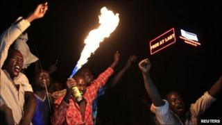 """People take part in South Sudan""""s independence day celebrations near the countdown clock in Juba on 9 July 2011"""