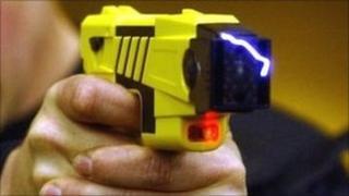 Police officer demonstrates a Taser gun