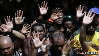 Workers from Freeport-McMoran Copper Gold Inc gather to pray during a week long strike in Kuala Kencana, Timika, in Indonesia's Papua province 11 July 2011