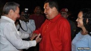Cuba' President Raul Castro ((left) greets Venezuela's President Hugo Chavez and his daughter Rosa Virginia at Havana airport