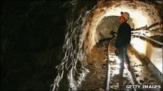 Man in mine tunnel