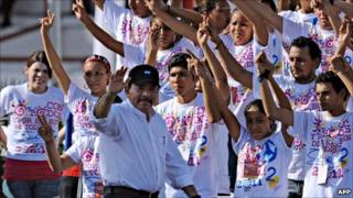 Nicaraguan President Daniel Ortega waves supporters during the celebration of the 32nd anniversary of the Sandinista Revolution, 19 July 2011