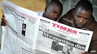 Newspaper readers in Zambia