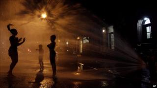 Children playing in hydrant water