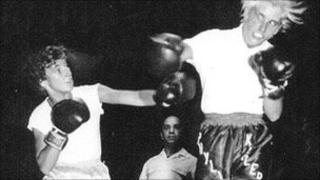 Barbara Butterick throwing a punch at Phyllis Kugler