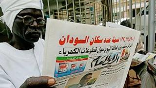 Newspaper reader in Sudan