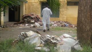 Destroyed records on the lawn of Nowshera's Tehsil office, or office of land administration