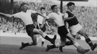 Jimmy McIlroy (far right) in action during his heyday