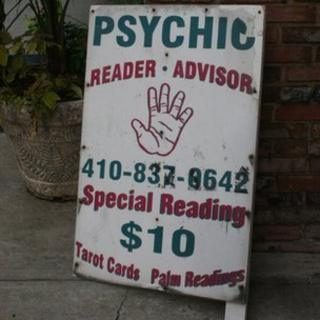 street sign for psychic reader