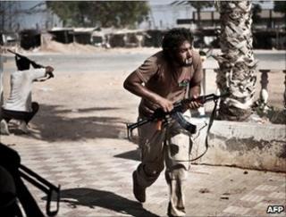 Libyan rebels come under fire just beyond Bir al-Ghanam, 6 August