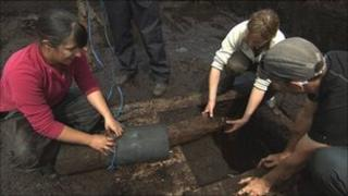 Archaeologists raising the timber road