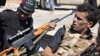 Libyan rebels in the back of a pick-up truck near Zawiya, Libya, 13 August 2011