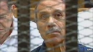 Egypt's former Interior Minister Habib al-Adly sits in a cage during his trial - 3 August 2011