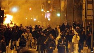 Hooded youth during riots in Liverpool